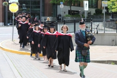 Piper leading students to Port Theatre (Anthropology in front)