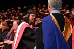 Sharae receiving degree from John Black, Dean of Social Sciences