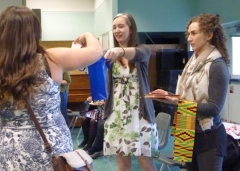 Raffle draw held at the Anthropology Forum 2018; Jessica holding bag with names and Victoria with prizes.
