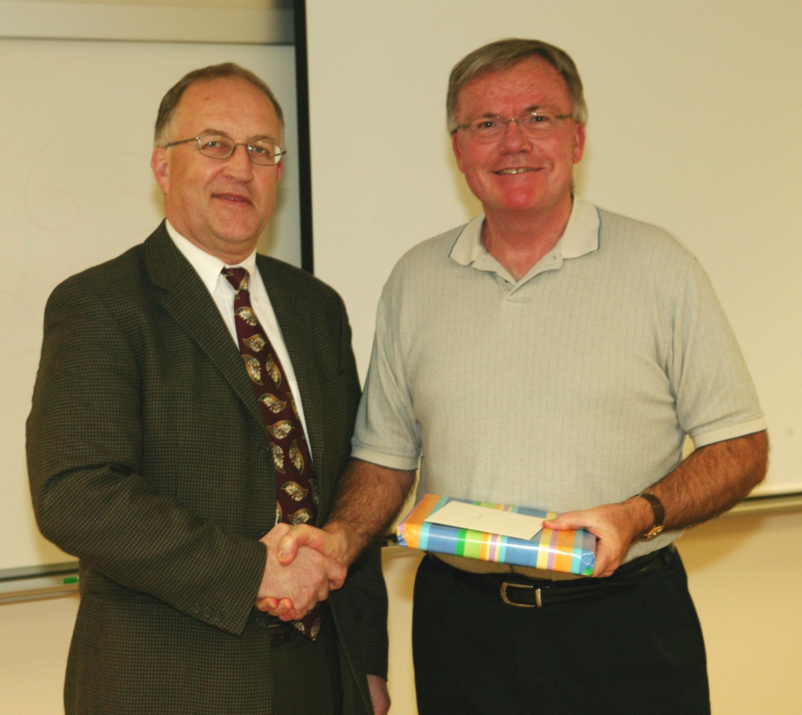 Dr. Ralph Nilsen, President of Vancouver Island University presents a gift of appreciation to Dr. Don Stone, outgoing Chairman of the Geography Department, who retired in 2008