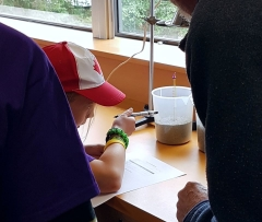 A GKU student recording temperature